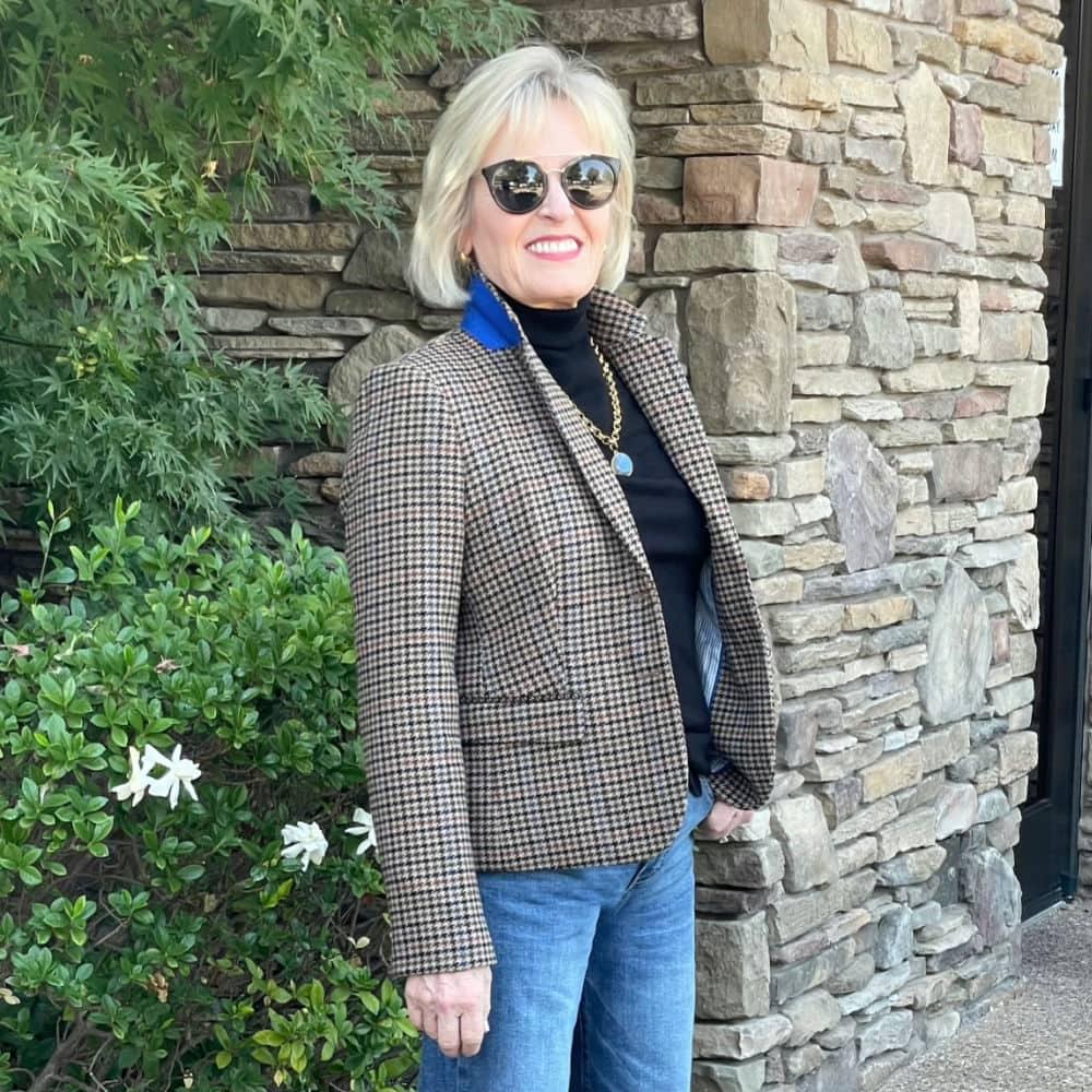 blonde woman wearing houndstooth blazer and black turtleneck