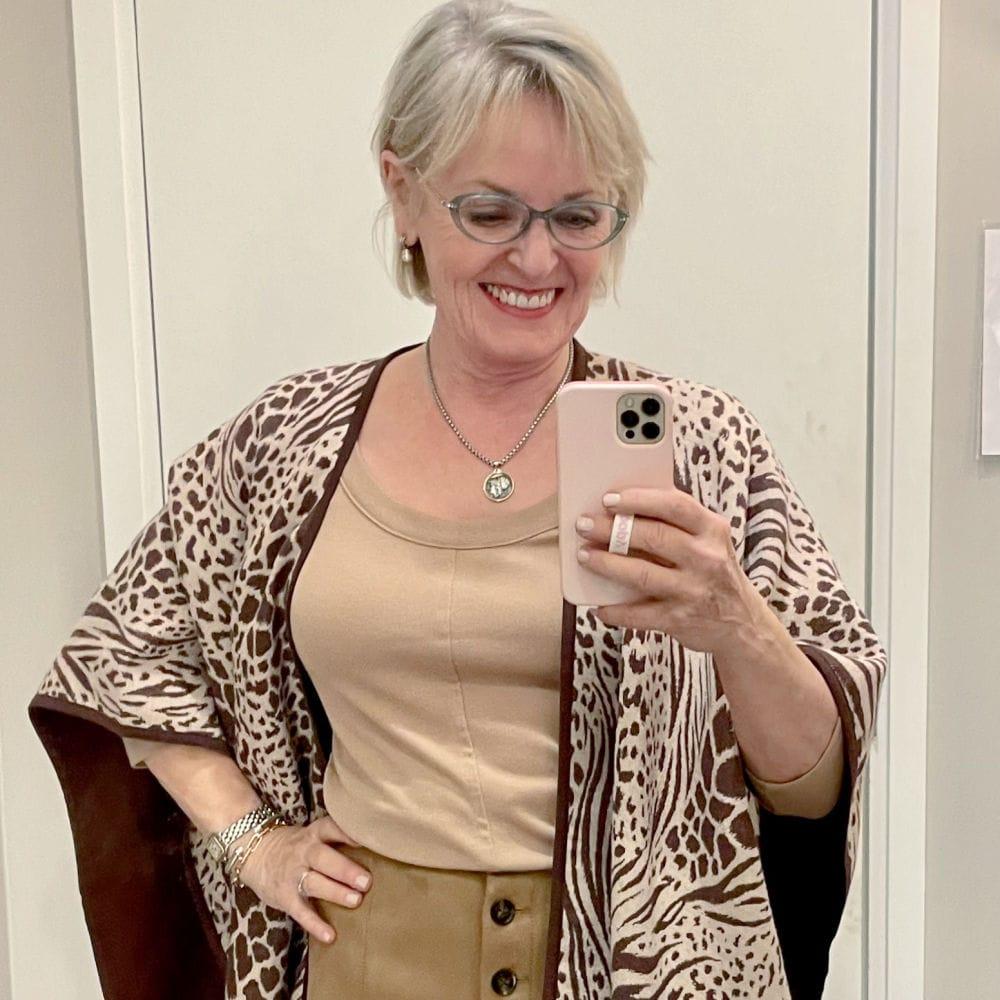 blonde woman wearing ann taylor poncho