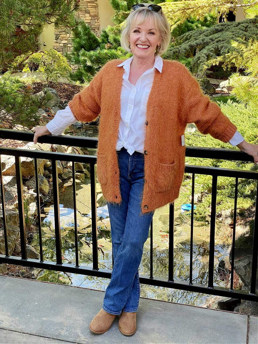 jennifer connolly wearing rust colored cardigan outfit