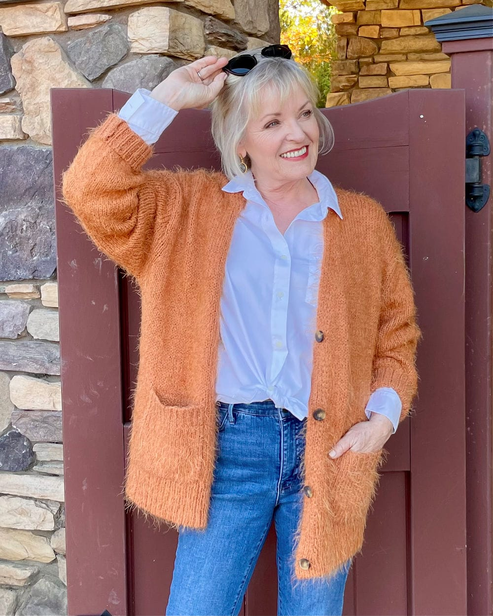 wearing rust cardigan with jeans and white shirt
